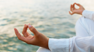 hands of person meditating